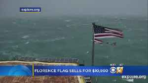 US Flag Shredded By Florence Sells For $10,900 [Video]