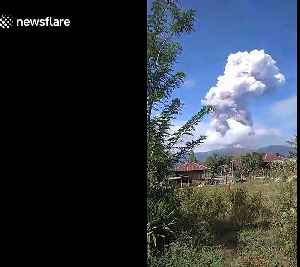 Thick ash column hangs in sky after volcano erupts on earthquake-devastated Indonesia island [Video]