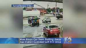 Man Stops Car From Rolling Into Traffic At Gas Station [Video]