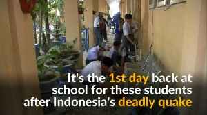 Indonesia students help school clean-up on first day back after deadly quake [Video]