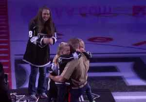 Marine Surprises Family at LA Kings Opening Game [Video]