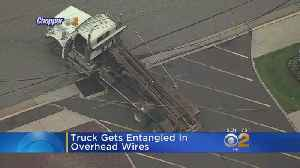 Truck Entangled In Power Lines [Video]