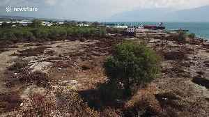 Drone footage shows large ship swept onto land by force of Palu tsunami [Video]