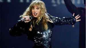 Taylor Swift Wears Thigh-High Boots And Minidress At AMA [Video]