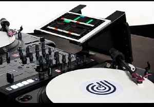 News video: D.BEAM scratch routine using CONDUCTR 2, Traktor & Ableton Live iPad controller.