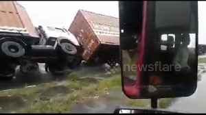 Cyclone Titli overturns several heavy trucks on Indian highway [Video]