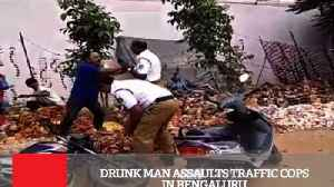 Drunk Man Assaults Traffic Cops In Bengaluru [Video]