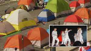 Fans Brave Weather to Watch K-Pop Band BTS Perform [Video]
