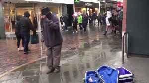 Disabled man breaks into dance by busker [Video]