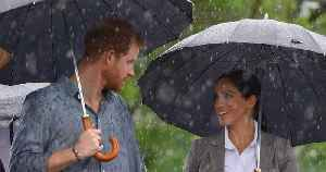 Prince Harry and Meghan Markle Cuddle in the Rain Moments After Visiting Drought-Stricken Farm [Video]