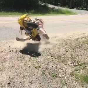 Girl Falls After Popping Wheelie on a Minibike [Video]