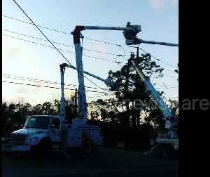 Linemen restore power in hurricane-hit Florida Panhandle as 155,000 still without [Video]