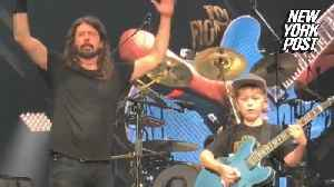 Boy who rocked with the Foo Fighters raises big bucks for sick friend [Video]
