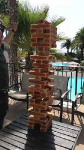 Dad Tries to Remove Jenga Block with Karate Chop and Fails [Video]