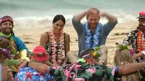 News video: Prince Harry and Meghan group hug on Bondi beach