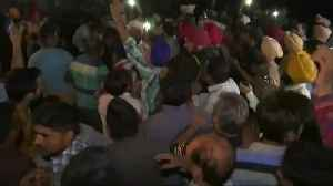 At least 59 dead as train crashes into crowd in India [Video]