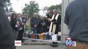 Complimentary burial held at Catholic cemetery [Video]