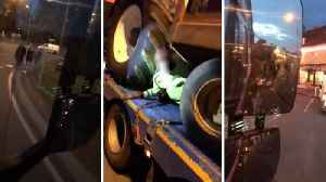 Watch: Shocking footage shows moment 19 migrants hauled off Irish lorry in French port [Video]