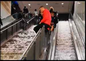 Hail and Floodwater Cascade Down Escalator at Rome Metro Station [Video]