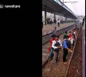 Commuters in Mumbai board packed rush-hour train from the wrong side [Video]