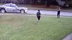 Cop plays catch with boy tossing football by himself [Video]