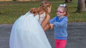 5-year-old girl with autism mistakes bride for Cinderella, has magical moment with kind stranger [Video]