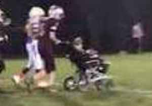 Disabled 7-Year-Old Opens Brother's Football Game With Inspirational Touchdown [Video]