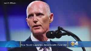 Gov. Scott Defends Health Care Record In New Ad [Video]