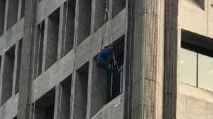 Construction Worker Rescued After Being Suspended from 9-Story Building [Video]