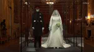 Right Now: Prince Harry and Meghan Markle's Wedding Attire is Star Attraction at Windsor Exhibition [Video]