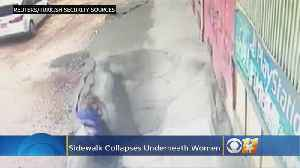 Two Women Fall Through 'Cloud Of Dust' After Sidewalk Collapse [Video]