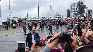 Pregnant Meghan Markle clutches belly as royal couple meets public in downtown Auckland [Video]