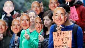 Why Activists In Jeff Bezos Masks Protested At Amazon Headquarters [Video]