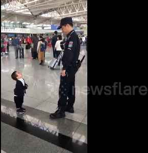 Cute boy just wants a hug from airport security guard [Video]