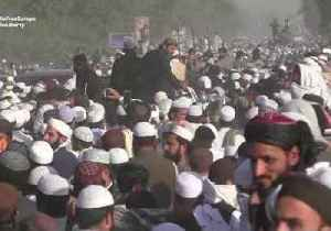 Thousands Attend Funeral of Pakistani Cleric Known as 'Father of the Taliban' [Video]