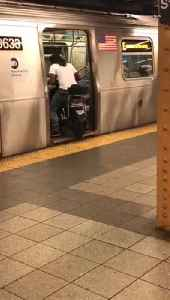 Man in white shirt drives motorcycle into subway train [Video]