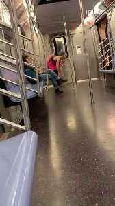 Drunk man with pink cowboy hat costume spins on subway [Video]