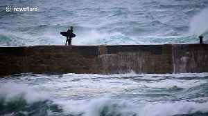 Surfer swept off his feet at Cornwall beach by strong post-Hurricane Oscar waves [Video]
