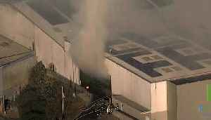 RECYCLING FIRE: Raw helicopter video of smoky fire burning inside Recology facility in Brisbane [Video]