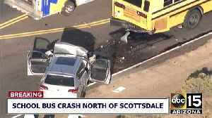 Two people injured after a car collided with a school bus near north Scottsdale [Video]