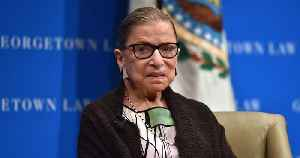 Supreme Court Justice Ruth Bader Ginsburg Hospitalized After Fracturing Ribs in Fall [Video]