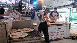 Argentinians beat Italians at pizza world record [Video]