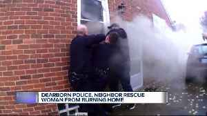 Video shows Dearborn officers rescue unconscious woman from burning home [Video]