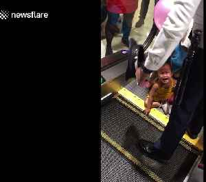 Harrowing moment two-year-old girl is rescued after getting fingers stuck in escalator [Video]