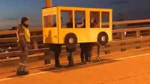 Watch: Russians dress up as a bus to cross vehicle-only bridge [Video]