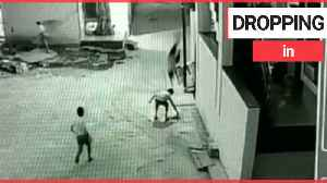Boy miraculously survives 40ft plunge from rooftop after landing on friend [Video]