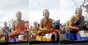 Procession Of Life-Like Buddhist Monk Statues [Video]