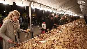 Buenos nachos! More than 2,000 kilos of nachos break unofficial record for the world's largest plate [Video]