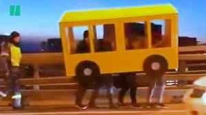 Four Guys Dress As A Bus To Cross Vehicle-Only Bridge In Russia [Video]