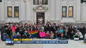 Baraboo community protests hateful photo by posing with symbols of love [Video]
